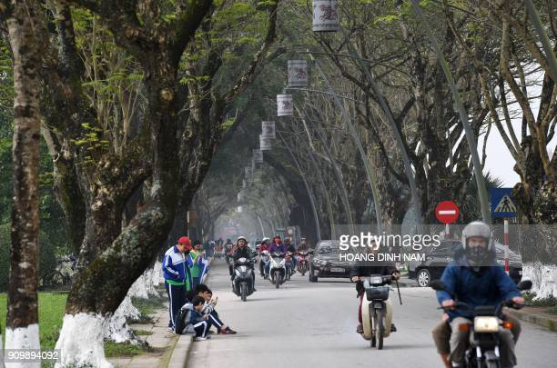 In this picture taken on January 17 traffic moves along a street near the former imperial citadel in Hue where fierce fighting took place during the...