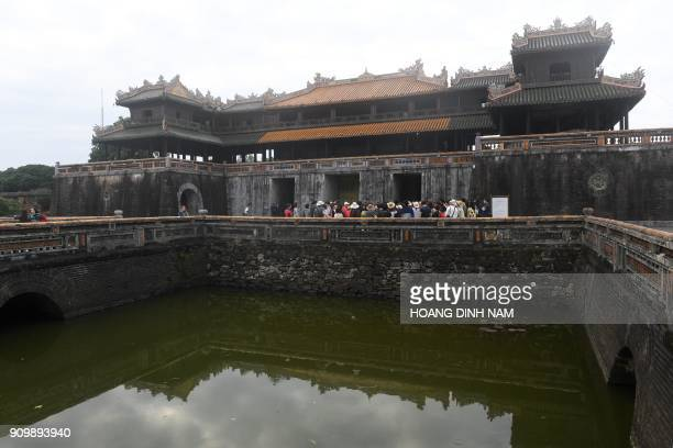 In this picture taken on January 18 tourists visit the former imperial citadel where fierce fighting took place during the 1968 'Tet Offensive' in...