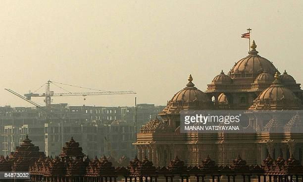 In this picture taken on January 19 an underconstruction 2010 Commonwealth Games Village site is seen in the background of the Hindu Akshardham...