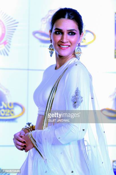 In this picture taken on January 19 Bollywood actress Kriti Sanon poses for photographs as she arrives to attend the annual 'Umang Mumbai Police...