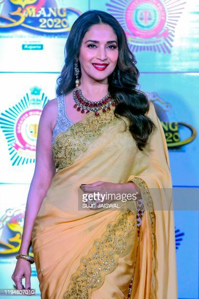 In this picture taken on January 19 Bollywood actress Madhuri Dixit poses for photographs as she arrives to attend the annual 'Umang Mumbai Police...