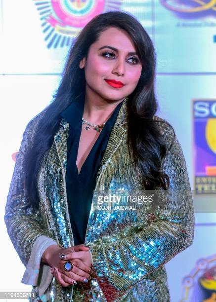 In this picture taken on January 19 Bollywood actress Rani Mukherjee poses for photographs as she arrives to attend the annual 'Umang Mumbai Police...
