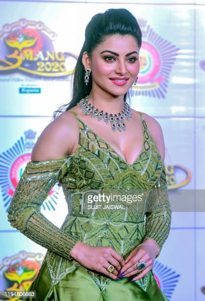 In this picture taken on January 19 Bollywood actress Urvashi Rautela poses for photographs as she arrives to attend the annual 'Umang Mumbai Police...