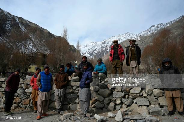 In this picture taken on January 22, 2021 villagers gather in Sadpera village, some 30 Km from Skardu of Gilgit-Baltistan region in northern Pakistan.