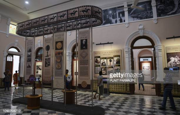 In this picture taken on January 22 visitors browse through exhibits at the National Museum of Indian Cinema the country's first museum showcasing...