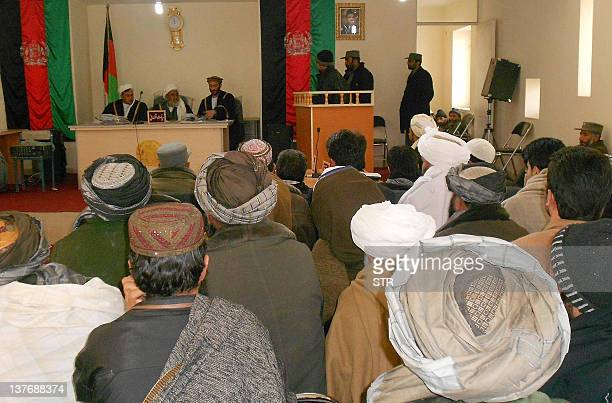 In this picture taken on January 24 2012 an Afghan man Mahmmood listens to a court judge during his trial in Herat An Afghan man found in possession...