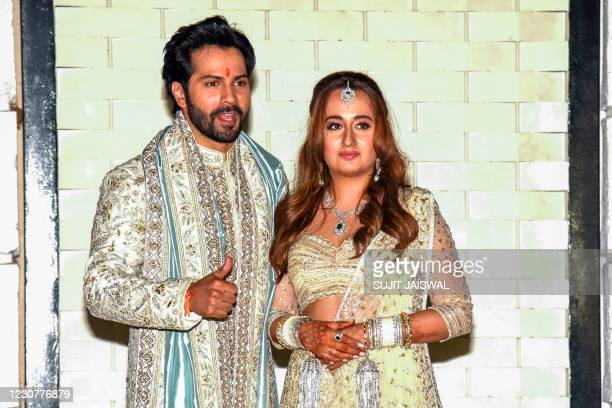 In this picture taken on January 24 Bollywood actor Varun Dhawan and fashion designer Natasha Dalal pose after their wedding in Alibag.
