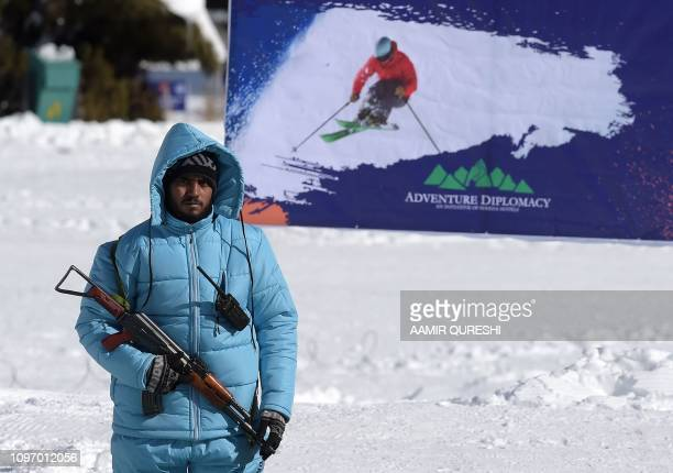 In this picture taken on January 29 a Pakistani security personnel looks on during the CAS Karakoram International Alpine Ski Cup taking place at the...