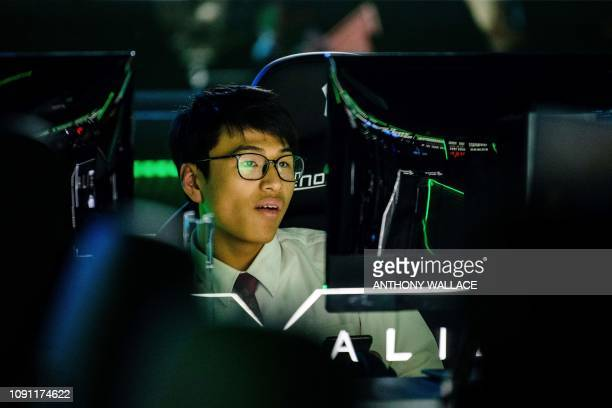 In this picture taken on January 29 a young man reacts as he uses a console at the Cyber Games Arena eSports venue in the Mongkok district of Kowloon...
