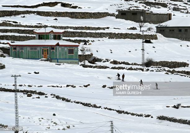 In this picture taken on January 29 Pakistani children ski on a snowcovered street next to their homes near the slopes where the CAS Karakoram...