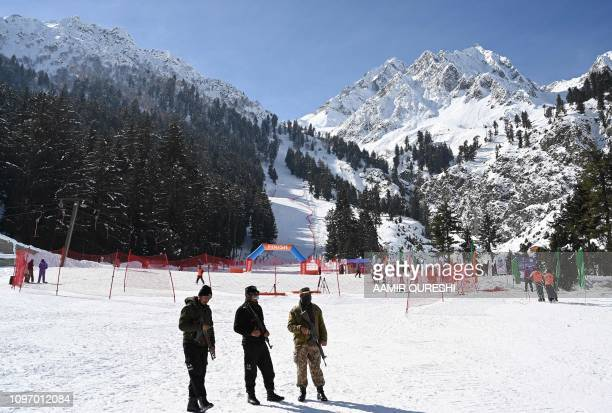 In this picture taken on January 29 Pakistani security personnel stand guard during the CAS Karakoram International Alpine Ski Cup taking place at...