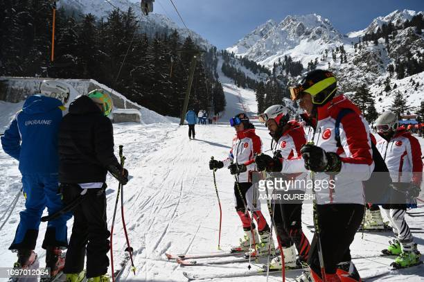 In this picture taken on January 29 Turkish and Ukrainian skiers make their way to a slope to compete in the CAS Karakoram International Alpine Ski...