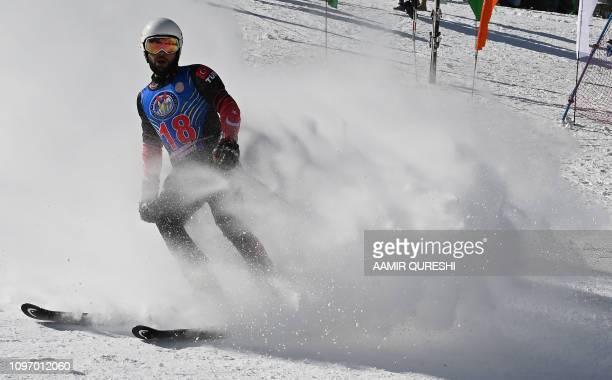 In this picture taken on January 29 Turkish skier Berkin Usta takes part in the CAS Karakoram International Alpine Ski Cup at the Pakistan Air...