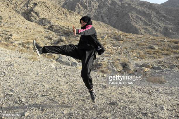 In this picture taken on January 31 a female student of the Hazara community practises Shaolin Kung Fu during a self-defence martial arts training...