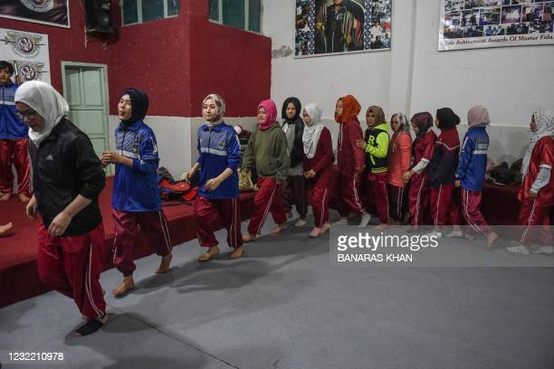 In this picture taken on January 31 female students of the Hazara community warm-up before a martial arts training class at the Kazmi International...