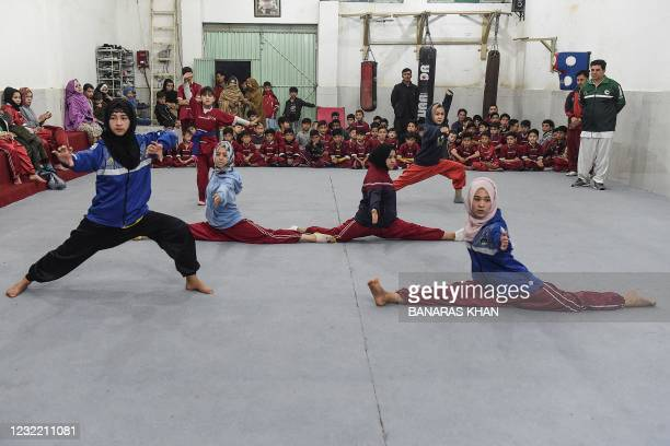 In this picture taken on January 31 female students of the Hazara community take part in a martial arts training class at the Kazmi International...