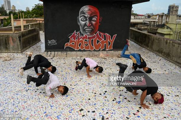 In this picture taken on July 02, 2021 coach Vikram Godakiya warm up along with the students during a group class to learn breaking or 'b-boying' at...