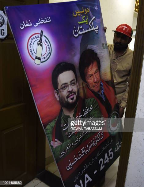 In this picture taken on July 11 a supporter of Aamir Liaquat Hussain, a televangelist and an election candidate of political party Pakistan...