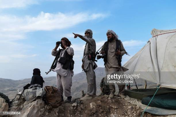 In this picture taken on July 15 Afghan militia fighters keep a watch at an outpost against Taliban insurgents at Charkint district in Balkh Province.