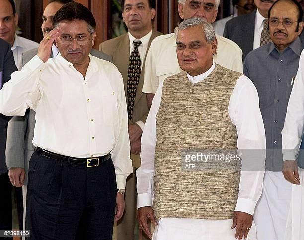 In this picture taken on July 15 Pakistani President Pervez Musharraf salutes the media as Indian Prime Minister Atal Behari Vajpayee looks on prior...