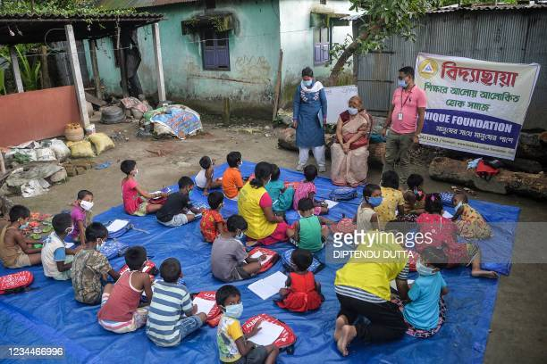 In this picture taken on July 23 children of a low-income neighbourhood attend a class at an open-air school 'Vidyachaya' set up by the non-profit...