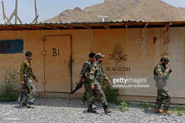 In this picture taken on July 26 Afghan National Army soldiers walk in a US military base, which has been recently handed over to Afghan forces in...