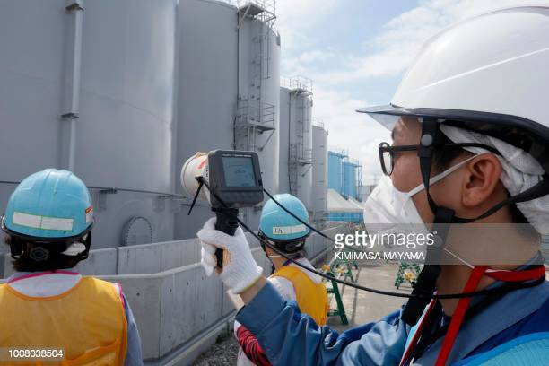 TOPSHOT In this picture taken on July 27 2018 and made available on July 30 a staff member of Tokyo Electric Power Company measures radiation levels...