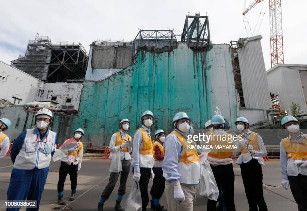 TOPSHOT In this picture taken on July 27 2018 and made available on July 30 foreign journalists receive information about decommissioning works...