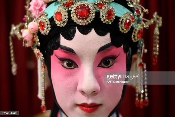 In this picture taken on July 28 2017 Chinese Cantonese opera actress Mia Zhao from Beijing poses backstage before an opera performance in Kuala...