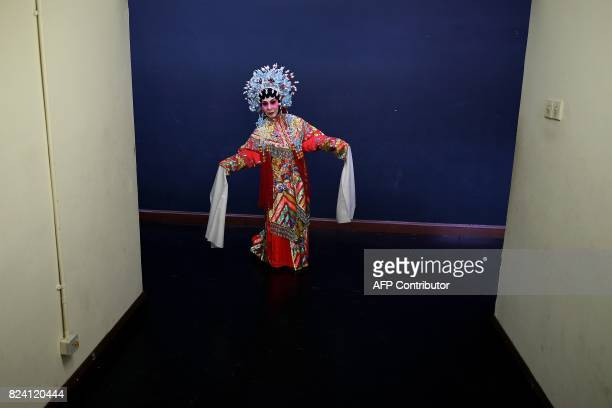 In this picture taken on July 28 2017 ethnic MalaysianChinese Cantonese opera actress Veronica Davis from the Sound of Tai Hei group rehearses...