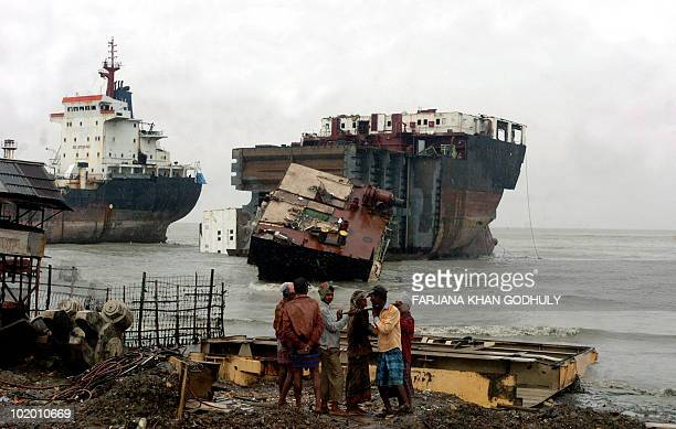 In this picture taken on July 29 Bangladeshi labourers work infront of docked ships at a shipbreaking yard in Sitakundu on the outskirts of...