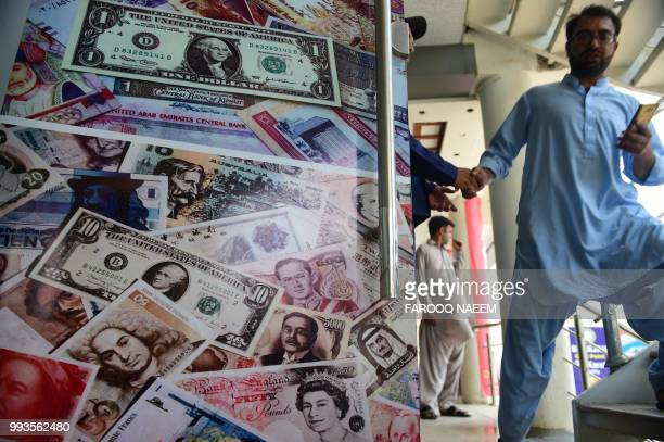 In this picture taken on July 3 a Pakistani man comes out from a currency exchange shop in Rawalpindi Pakistan's next government to be chosen in a...