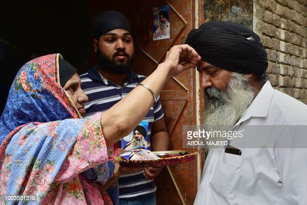 In this picture taken on July 3 the mother of Radesh Singh Tony a minority Sikh candidate contesting an upcoming Pakistani general election seat...