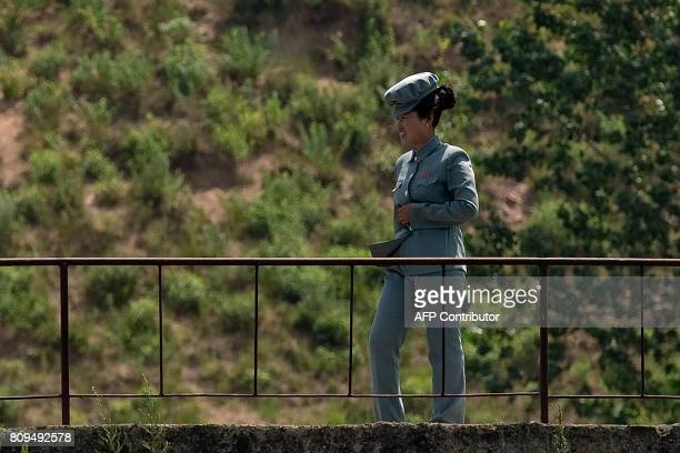 In this picture taken on July 5 2017 a North Korean soldier walks on the banks of the Yalu river near Sinuiju opposite the Chinese border city of...