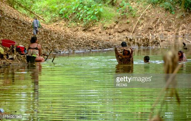 In this picture taken on July 5 villagers wash their clothes in the shrinking Cipamingkis river in Bekasi West Java province