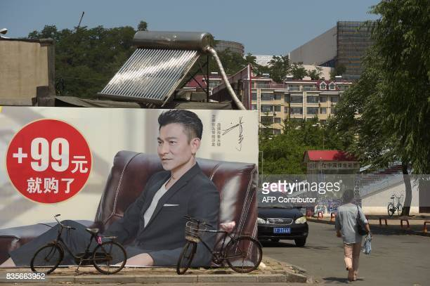 In this picture taken on July 6 a solar water heater is seen on the roof of a shop in Dandong At the Chinese border with North Korea solar panel...