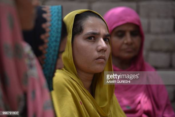In this picture taken on July 7 Pakistani villagers who never voted in past general elections listen to a Pakistani social worker and member of...