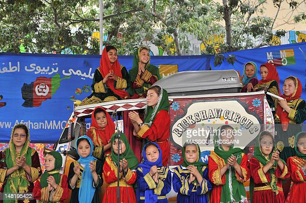 In this picture taken on July 9 Afghan children from the Mobile Mini Circus for Children sing in Kabul. A German-Canadian couple decided to do a...