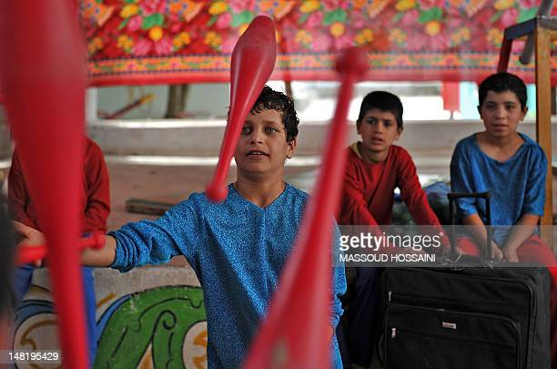 In this picture taken on July 9 an Afghan boy from the Mobile Mini Circus for Children performs in Kabul. A German-Canadian couple decided to do a...