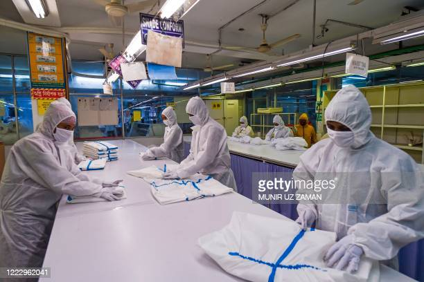 In this picture taken on June 18 labourers fromBeximco TextilesLtdmanufacturerwork on Personal Protective Equipment garment used as a preventive...
