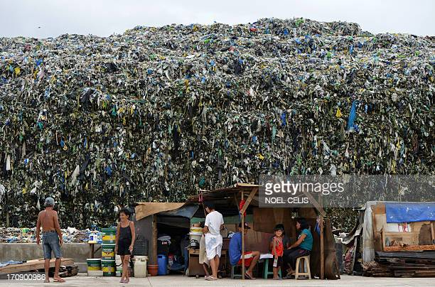 In this picture taken on June 19 2013 residents are seen at their near a dump site in Manila The Philippines financial capital banned disposable...