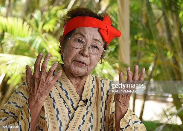 In this picture taken on June 22 86yearold Hideko Kedamori a member of an elderly women troupe of singers and dancers from Kohama Island in Okinawa...