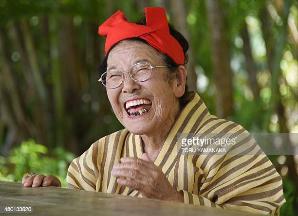 In this picture taken on June 22 92yearold Tomi Menaka a member of an elderly women troupe of singers and dancers from Kohama Island in Okinawa...