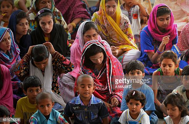 In this picture taken on June 22 internally displaced Pakistani Christians fleeing a military operation in the North Waziristan tribal agency attend...