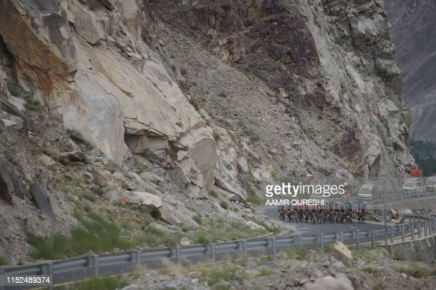 In this picture taken on June 27 Pakistani and international cyclists take part in Tour de Khunjrab cycling race on Karakaram highway near Pakistan's...