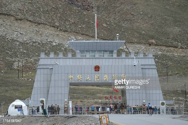 In this picture taken on June 30 a Pakistani cyclist rides past the Pakistan-China Khunjerab Pass, the world's highest paved border during the Tour...
