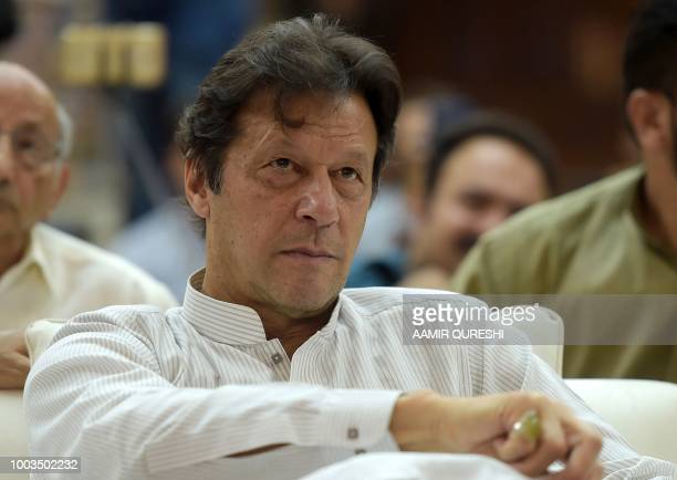 In this picture taken on June 30 Pakistani cricketer turned politician Imran Khan of the Pakistan Tehreek-e-Insaf attends an election campaign rally...