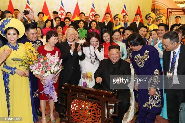 TOPSHOT In this picture taken on March 1 2019 and released by Vietnam News Agency on March 2 North Korea's leader Kim Jong Un plays Dan Bau a...
