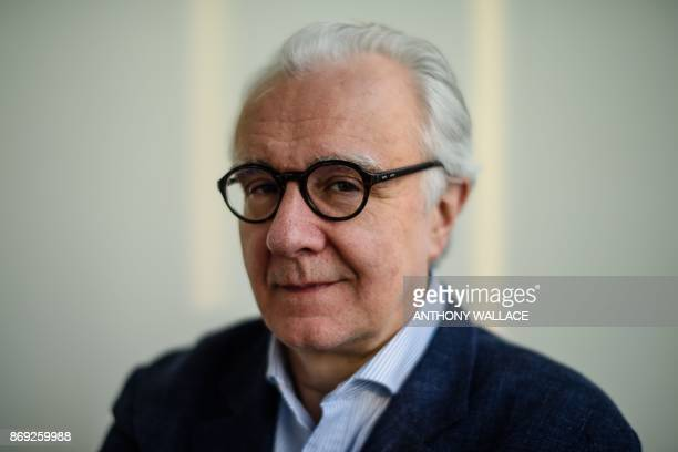 In this picture taken on March 1 Frenchborn Monégasque chef Alain Ducasse poses for a portrait at his restaurant 'Rech by Alain Ducasse' in Hong Kong...