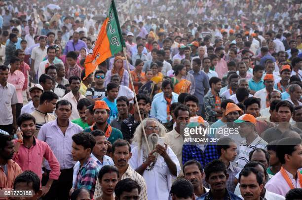 In this picture taken on March 10 Indian supporters of the Bharatiya Janata Party attend a mass protest rally against the murder of senior BJP leader...